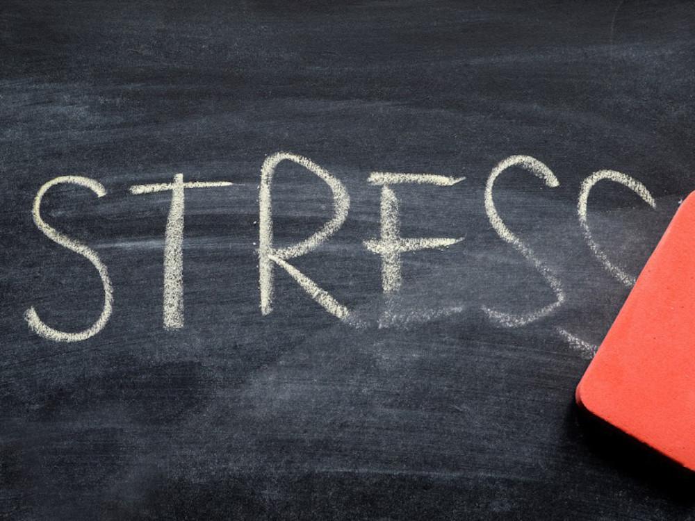 The word stress written on a chalkboard